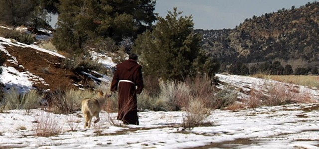 St. Francis walking with the wolf of Gubbio
